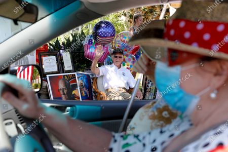 WWll Veteran Tom Rice, 99 enjoyed his drive-by celebration in front of his home on Saturday, Aug. 15, 2020 in Coronado, CA. The veteran and retired school teacher celebrated his 99th birthday with family and friends. Rice was in the Army's 101st Airborne Division on D-Day and the first to jump out of his C-47 after it crossed the English Channel. After the war, he returned to San Diego and taught history at Chula Vista and Hilltop high schools for more than 40 years. (Nelvin C. Cepeda / The San Diego Union-Tribune)
