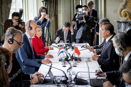 Dutch Minister of Foreign Affairs Stef Blok (2-L) receives his Chinese colleague Wang Yi (2-R) at Duivenvoorde Castle in Voorschoten, The Netherlands, 26 August 2020. The minister is touring various countries to achieve more cooperation between China and Europe.