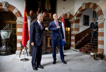 Dutch Minister of Foreign Affairs Stef Blok (R) receives his Chinese colleague Wang Yi at Duivenvoorde Castle in Voorschoten, The Netherlands, 26 August 2020. The minister is touring various countries to achieve more cooperation between China and Europe.