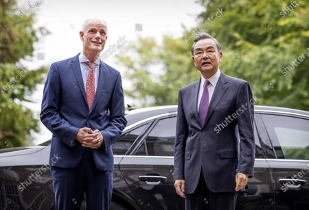 Dutch Minister of Foreign Affairs Stef Blok (L) receives his Chinese colleague Wang Yi (R) at Duivenvoorde Castle in Voorschoten, The Netherlands, 26 August 2020. The minister is touring various countries to achieve more cooperation between China and Europe.