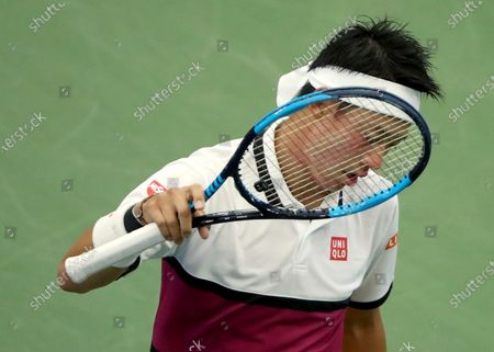 """Kei Nishikori, of Japan, reacts after losing a point to Bradley Klahn during the second round of the U.S. Open tennis championships in New York. Nishikori, the 2014 U.S. Open runner-up, said he tested negative for COVID-19 after having two positive tests but still decided to withdraw from the Grand Slam tournament that begins next week. Nishikori wrote, on his mobile app that he is ready to """"slowly"""" return to practice - but not prepared to compete in best-of-five-set matches"""