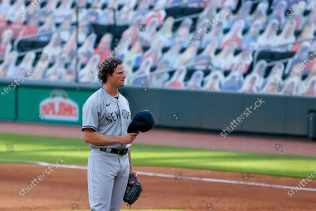 New York Yankees starting pitcher Gerrit Cole reacts during the sixth inning of game 1 of a MLB doubleheader baseball game between the New York Yankees and the Atlanta Braves at Truist Park in Atlanta, Georgia, USA, 26 August 2020.