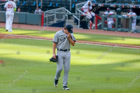 New York Yankees starting pitcher Gerrit Cole reacts after getting replaced in the sixth inning of game 1 of a MLB doubleheader baseball game between the New York Yankees and the Atlanta Braves at Truist Park in Atlanta, Georgia, USA, 26 August 2020.