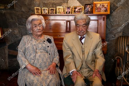 Ecuadorians Julio Cesar Mora Tapia (R), 110, and Waldramina Maclovia Quinteros (L), 104, pose during an interview in Quito, Ecuador, 26 August 2020. Julio Cesar and Waldramina entered the Guinness World Records book as the oldest married couple on the world.