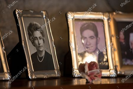 View of pictures at the house of Ecuadorians Julio Cesar Mora Tapia (R), 110, and Waldramina Maclovia Quinteros (L), 104, during an interview in Quito, Ecuador, 26 August 2020. Julio Cesar and Waldramina entered the Guinness World Records book as the oldest married couple on the world.