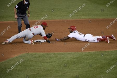 Washington Nationals' Howie Kendrick, right, slides into second with a double as Philadelphia Phillies second baseman Jean Segura tries to make the play during the ninth inning of a baseball game, in Washington. The Phillies won 3-2