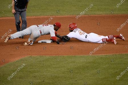 Washington Nationals' Howie Kendrick slides into second with a double next to Philadelphia Phillies second baseman Jean Segura during the ninth inning of a baseball game, in Washington. The Phillies won 3-2