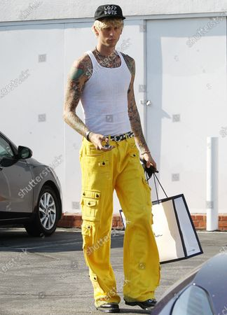 Stock Picture of Machine Gun Kelly leaving Fred Seagal