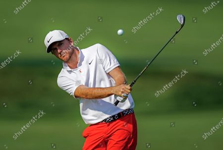 Russell Henley of the US hits to the eighteenth green during practice for the BMW Championship golf tournament at Olympia Fields Country Club in Olympia Fields, Illinois, USA, 26 August 2020. The BMW Championship is the second of the FedEx Cup playoffs and will be played 27 August to 30 August.