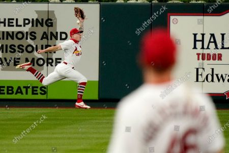 Stock Image of St. Louis Cardinals left fielder Tyler O'Neill in unable to catch a two-run double by Kansas City Royals' Whit Merrifield as Cardinals first baseman Paul Goldschmidt, right, watches during the ninth inning of a baseball game, in St. Louis