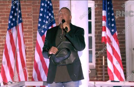 Stock Image of In this image from the Republican National Convention video feed, Trace Adkins sings the National Anthem following United States Vice President Mike Pence's delivering his acceptance speech as the 2020 Republican Party Candidate for Vice President of the US during the third day of the convention.