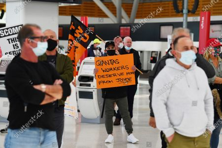 QANTAS baggage handlers and ground staff hold a protest in the QANTAS Dometic terminal in Sydney, Australia, 27 August 2020. Qantas has announced that it will slash over 2400 jobs, prompting unions to call on the federal government to intervene.