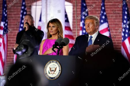 Stock Picture of President Donald Trump and first Lady Melania Trump stand as Trace Adkins sings the National Anthem on the third day of the Republican National Convention at Fort McHenry National Monument and Historic Shrine in Baltimore