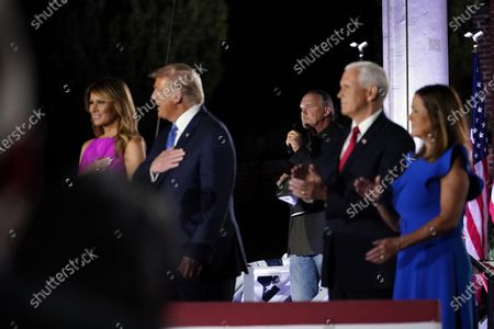Stock Photo of President Donald Trump and first lady Melania Trump stand with Vice President Mike Pence and Karen Pence as Trace Adkins sings the National Anthem on the third day of the Republican National Convention at Fort McHenry National Monument and Historic Shrine in Baltimore