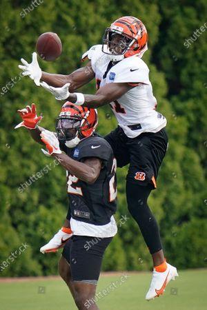 Cincinnati Bengals wide receiver John Ross III (11) catches a pass over cornerback William Jackson III (22) during NFL football training camp in Cincinnati