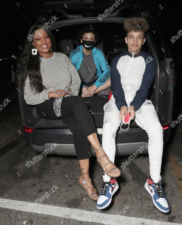 "Stock Image of Garcelle Beauvais with sons Jaid Thomas Nilon and Jax Joseph Nilon at ""A Night at the Drive-in"" Closing Night presents by Amazon Studios and Outlier Society on Wednesday, August 26th at the Paramount Drive-In in Los Angeles."