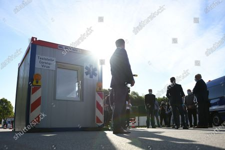 Bavaria's Interior Minister Joachim Herrmann (R) arrives at a COVID-19 test station in Deggendorf, Germany, 27 August 2020. In its efforts to control the ongoing pandemic of the COVID-19 disease caused by the SARS-CoV-2 coronavirus, Bavaria is installing a network of coronavirus test stations in all of its 71 districts and 25 free cities.