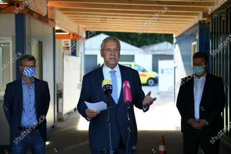 (L-R) Bavaria's Science Minister Bernd Sibler, Bavaria's Interior Minister Joachim Herrmann and President of the Bavarian District's Council Christian Bernreiter deliver a press statement at a COVID-19 test station in Deggendorf, Germany, 27 August 2020. In its efforts to control the ongoing pandemic of the COVID-19 disease caused by the SARS-CoV-2 coronavirus, Bavaria is installing a network of coronavirus test stations in all of its 71 districts and 25 free cities.