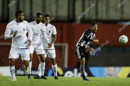 Keisuke Honda of Botafogo takes a direct free kick