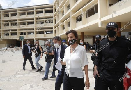 UNESCO'S Director-General Audrey Azoulay, center right, visits a school that was damaged by the Aug. 4 explosion that hit the seaport of Beirut, Lebanon, . Azoulay is in Beirut for two days to mobilize the international community and make education, culture and heritage the main pillars of reconstruction efforts in the wake of the devastation