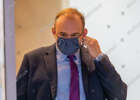 Ed Davey wearing a face mask leaves the Conrad Hotel in Westminster after being elected as the new Lib Dem leader. Sir Ed Davey MP for Kingston and Surbiton in South West London has been elected to lead the Lib Dem Party. He beat rival candidate Layla Moran by more than 18,000 votes .