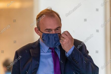 Stock Image of Ed Davey wearing a face mask leaves the Conrad Hotel in Westminster after being elected as the new Lib Dem leader. Sir Ed Davey MP for Kingston and Surbiton in South West London has been elected to lead the Lib Dem Party. He beat rival candidate Layla Moran by more than 18,000 votes .