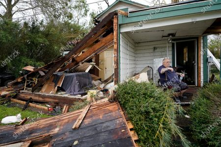 Stock Image of Chris Johnson views destruction at his home, in Lake Charles, La., after Hurricane Laura moved through the state. Johnson stayed in his home as the storm passed