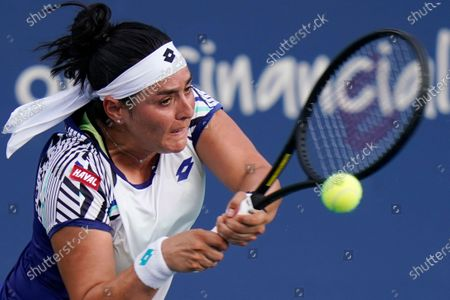 Ons Jabeur, of Tunisia, returns a shot from Christina Mchale during the third round at the Western & Southern Open tennis tournament in New York. Jabeur is scheduled to play in the U.S. Open, scheduled for Aug. 31-Sept. 13, 2020
