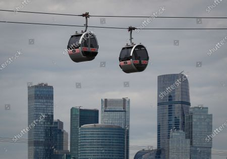 Cable car cabins are seen in front of the towers of business center Moscow City in Moscow, Russia, 27 August 2020.