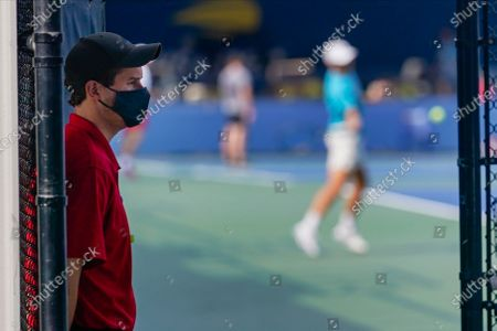 Security guard wearing a protective mask during the coronavirus pandemic as he watches over the entrance to a practice court during the Western & Southern Open tennis tournament at the Billie Jean King National Tennis Center, in New York. The tournament was put on hold for a day in a call for racial justice Thursday after Jacob Blake, a Black man, in Wisconsin was shot by police