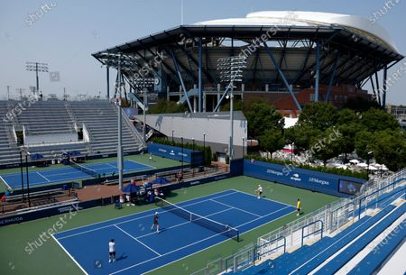 Players are seen practicing on courts 11 and12 on the grounds of the USTA Billie Jean King National Tennis Center at the Western and Southern Open in Flushing Meadows, New York, USA, 27 August 2020. Arthur Ashe Stadium is seen in the background.The tournament was put on hold for a day in protest of the police shooting of Jacob Blake in Wisconsin.