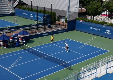 Players are seen practicing on courts 11 and 12 on the grounds of the USTA Billie Jean King National Tennis Center at the Western and Southern Open in Flushing Meadows, New York, USA, 27 August 2020. The tournament was put on hold for a day in protest of the police shooting of Jacob Blake in Wisconsin.