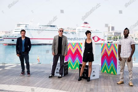 David Trueba (2-L), Spanish actors Vito Sanz (L) and Anna Alarcon (2-R), and Guinean actor Zidane Barry (R) pose during the presentation of the movie 'A este lado del mundo' (lit. this side of the world) at the Official Category of the 23rd edition of Malaga Film Festival, in Malaga, Spain, 27 August 2020. The festival, running from 21 to 30 August, was postponed due to the coronavirus lockdown last March.