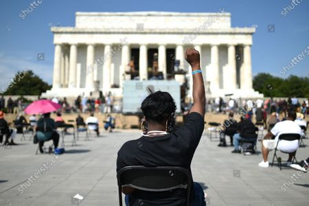 Activists sit in front of the Lincoln Memorial