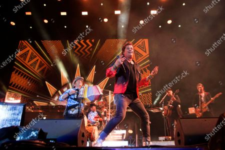 """Carlos Vives and accordion player Egidio Cuadrado perform at the Vive Latino music festival in Mexico City. Vives spent the last few years digging into the origins of the cumbia and vallenato music. The result: his 14th studio album, """"Cumbiana"""", and a 45-minute documentary: """"El Mundo Perdido de Cumbiana,"""" which translates to """"The Lost World of Cumbiana"""", released on"""