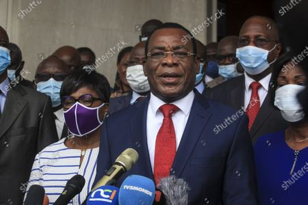Pascal Affi N'Guessan of the Ivorian Popular Front party of ex-President Laurent Gbagbo, center, accompanied by his wife Angeline Kili, center-left, speaks to the media after presenting his candidacy at the election commission in Abidjan, Ivory Coast . Two main opposition leaders in Ivory Coast who pose the strongest threat to incumbent President Alassane Ouattara are filing to become official candidates for their parties for October elections