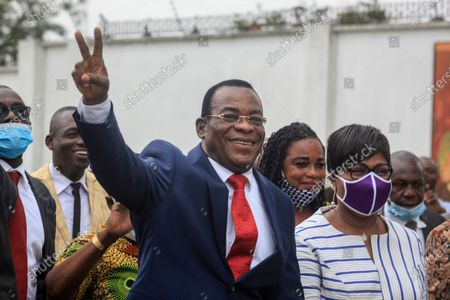 Pascal Affi N'Guessan of the Ivorian Popular Front party of ex-President Laurent Gbagbo, center, accompanied by his wife Angeline Kili, right, gestures to supporters after presenting his candidacy at the election commission in Abidjan, Ivory Coast . Two main opposition leaders in Ivory Coast who pose the strongest threat to incumbent President Alassane Ouattara are filing to become official candidates for their parties for October elections