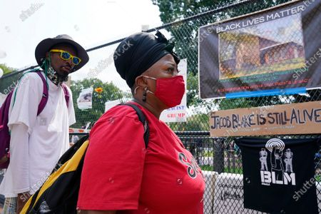 Lisa Robinson of Washington, D.C., visits a section of 16th Street, Northwest, renamed Black Lives Matter Plaza,, in Washington, prior to the March on Washington, which is being held on Friday at the Lincoln Memorial, which she will be attending