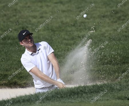 Russell Henley of the United States hits out of a trap to the 12th green during the first round of the 2020 BMW Championship held at the Olympia Fields Country Club in Olympia Fields, Illinois, USA, 27 August 2020.