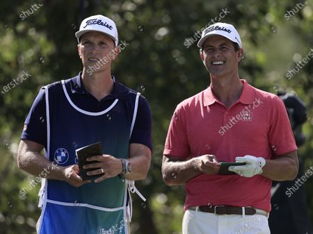 Adam Scott of Australia (R) and his caddie Mike Kerr (L) look down the 13th fairway from the tee box during the first round of the 2020 BMW Championship held at the Olympia Fields Country Club in Olympia Fields, Illinois, USA, 27 August 2020.