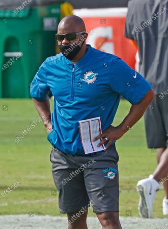 Miami Dolphins head coach Brian Flores looks on as the team warms up during an NFL football training camp practice in Davie, Fla. If Brian Flores is to become the Miami Dolphins' first Super Bowl coach since Don Shula, he needs for Tua Tagovailoa to become their best quarterback since Dan Marino