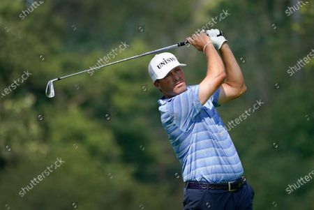 Ryan Palmer hits from the 12th tee during the first round of the BMW Championship golf tournament, at Olympia Fields Country Club in Olympia Fields, Ill
