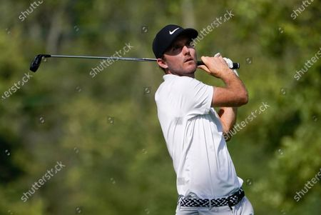 Russell Henley hits from the 12th tee during the first round of the BMW Championship golf tournament, at Olympia Fields Country Club in Olympia Fields, Ill