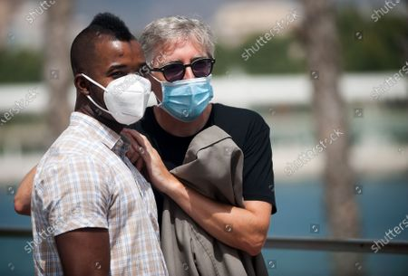 """Stock Picture of Spanish and subsaharan actor Zidane Barry and spanish director David Trueba wearing face masks pose during the photocall of the film """"A este lado del mundo"""" at Muelle Uno amid coronavirus crisis.  The 23 edition of Spanish Malaga Film Festival is the first great cinematographic event in Spain after it was postponed due to coronavirus pandemic last month of March. The organization has introduced measures to prevent the spread for coronavirus and to guarantee a secure event. The festival will be held from 21 to 30 August."""