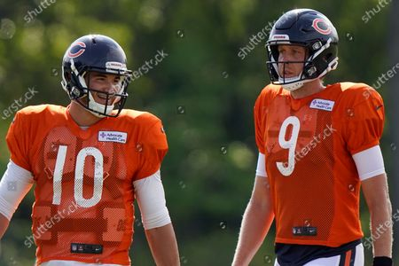 Chicago Bears quarterbacks Mitchell Trubisky, left, and Nick Foles walk on the field during an NFL football camp practice in Lake Forest, Ill. The Bears acquired Super Bowl 52 MVP Foles to compete with former No. 2 draft pick Trubisky for the starting quarterback job, one of several moves to shake up an offense that ranked among the NFL's worst last season