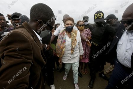 Former Liberian president Ellen Johnson Sirleaf (C) attends a peaceful anti-rape protest on a roadside in Monrovia, Liberia, 27 August 2020. According to reports, due to challenges such as corruption, institutional weaknesses, and lack of financial and logistical constraints, perpetrators enjoy the widespread culture of impunity of rape and sodomy against women, girls, and boys in Liberia.