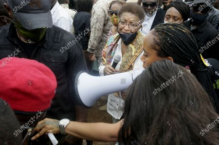 Stock Image of Former Liberian president Ellen Johnson Sirleaf (C) attends a peaceful anti-rape protest on a roadside in Monrovia, Liberia, 27 August 2020. According to reports, due to challenges such as corruption, institutional weaknesses, and lack of financial and logistical constraints, perpetrators enjoy the widespread culture of impunity of rape and sodomy against women, girls, and boys in Liberia.