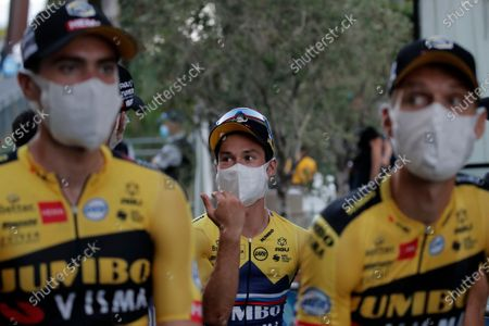 Slovenia's Primoz Roglic, center, Netherland's Tom Dumoulin, left, and German Tony Martin wear a face mask as they arrive for the 107th Tour de France cycling race team presentation, in Nice, southern France, ahead of upcoming Saturday's start of the race. The Tour de France sets off shrouded in uncertainty and riding in the face of the coronavirus pandemic and mounting infections in France