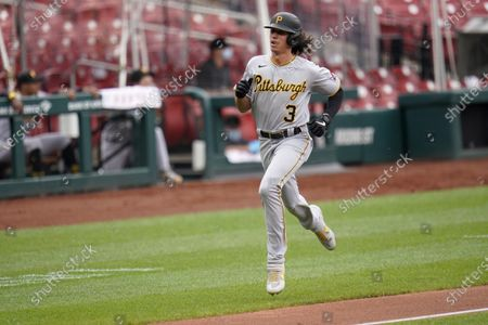 Pittsburgh Pirates' Cole Tucker jogs home to score on a single by Jacob Stallings during the fourth inning in the first game of a baseball doubleheader against the St. Louis Cardinals, in St. Louis
