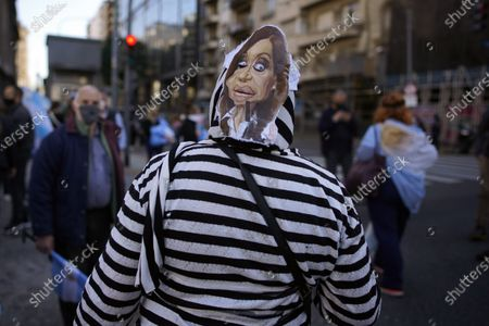 Woman with an image of Argentina's Vice President Cristina Fernandez on her head participates in a protest against judicial reforms proposed by the government, in front of Congress in Buenos Aires, Argentina, . The opposition claims the proposal is a move to place several judges sympathetic to the ruling Peronist administration in office